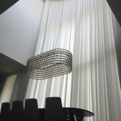 dining room with high sheer drapes